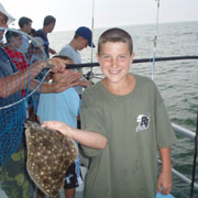 Nicholas Woska catching another huge Fluke on the Yankee3!